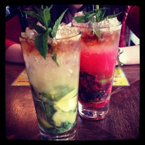A pineapple & a raspberry mojito